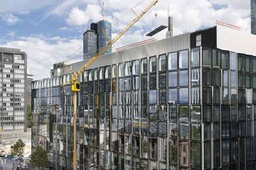 Wiesbauer's Liebherr MK 140 mobile construction crane working in Frankfurt's banking area